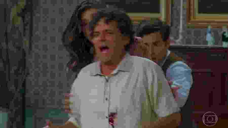 Américo (Felipe Camargo) leva tiro no lugar da filha Cris (Vitória Strada) - Reprodução/Globo