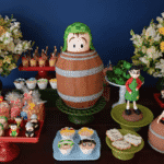 Detalhes da mesa de doces de Tatá Werneck; seu bolo teve formato do personagem Chaves em seu icônico barril - Reprodução/Instagram