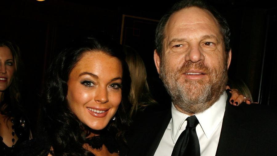 Lindsay Lohan posa ao lado do produtor Harvey Weisntein, acusado de assédio por dezenas de mulheres - Getty Images