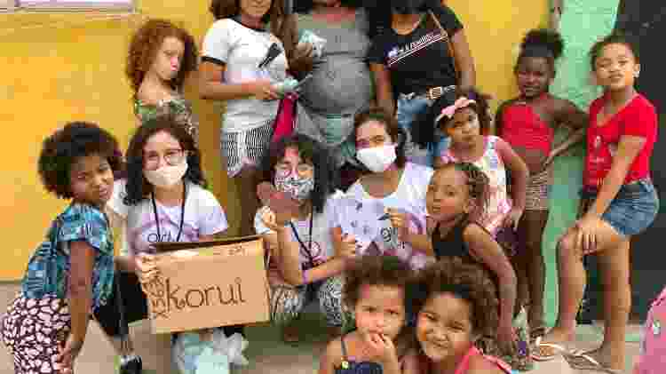 Meninas da Girl UP em ação da ONG que distribui produtos de higiene menstrual - Divulgação  - Divulgação