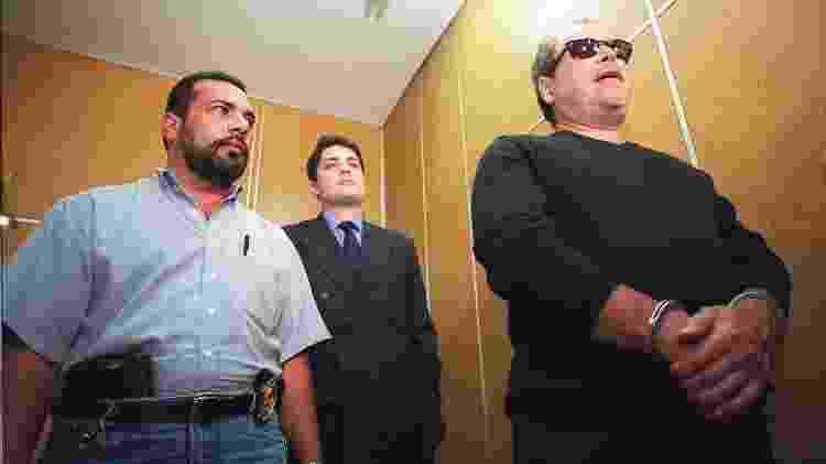 Peter Franklin Paul (de óculos escuros) presta depoimento na Polícia Federal em São Paulo - Jefferson Coppola/Folha Imagem - Jefferson Coppola/Folha Imagem