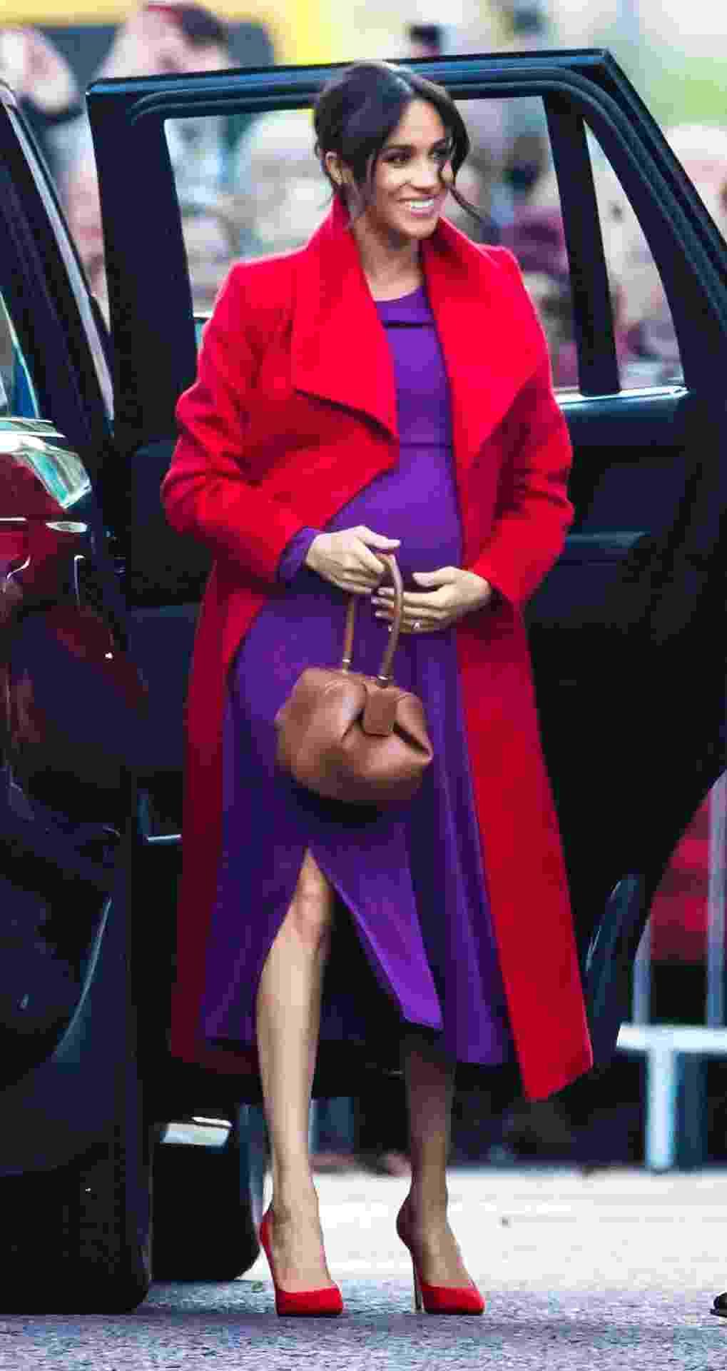 Meghan, a duquesa de Sussex, chegando a Birkenhead para uma visita ao lado do marido, o príncipe Harry, em 14 de janeiro - Getty Images