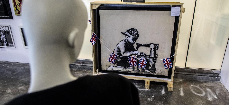 "A obra ""Slave Labour"", de Banksy -  Barbara Davidson/Getty Images"