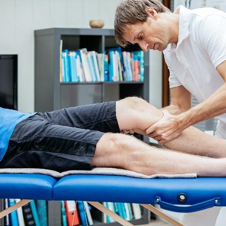 A massagem ajuda a aliviar a tensão muscular e minimizar dores pós-treino - iStock