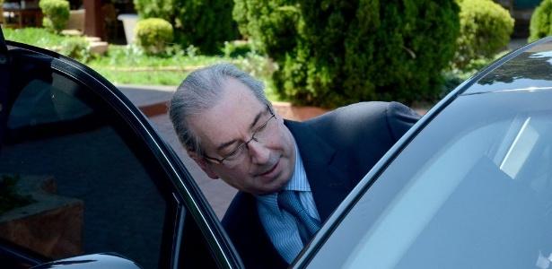 Eduardo Cunha entra em seu carro, em Brasília, onde foi preso