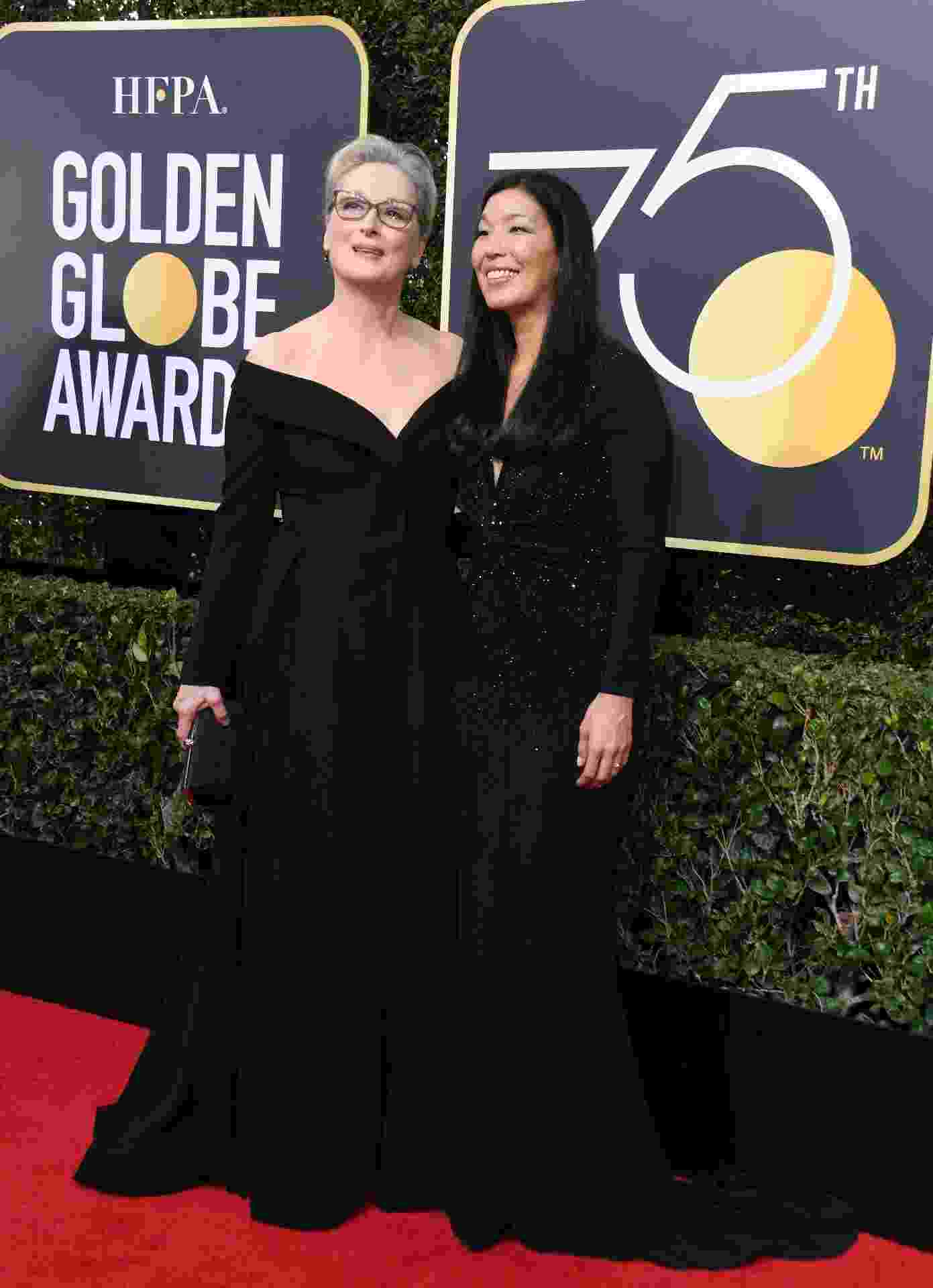 Meryl Streep vai ao Globo de Ouro 2018 ao lado de Ai-jen Poo, líder da organização National Domestic Workers Alliance - AFP
