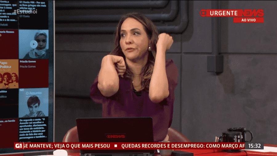 """29.mai.2020 - Maria Beltrão, do """"Estúdio i"""", faz mímica para explicar como abre portas em meio à pandemia de covid-19 - Reprodução/GloboNews"""