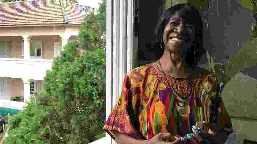 Há dois meses, Maria foi morar numa casa de repouso católica; aqui, posa para a BBC News Brasil na janela do seu quarto - Luiza Franco/BBC News Brasil