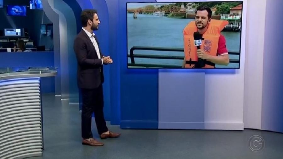 Repórter dá susto em apresentadores ao simular pulo em rio - Reprodução/TV TEM