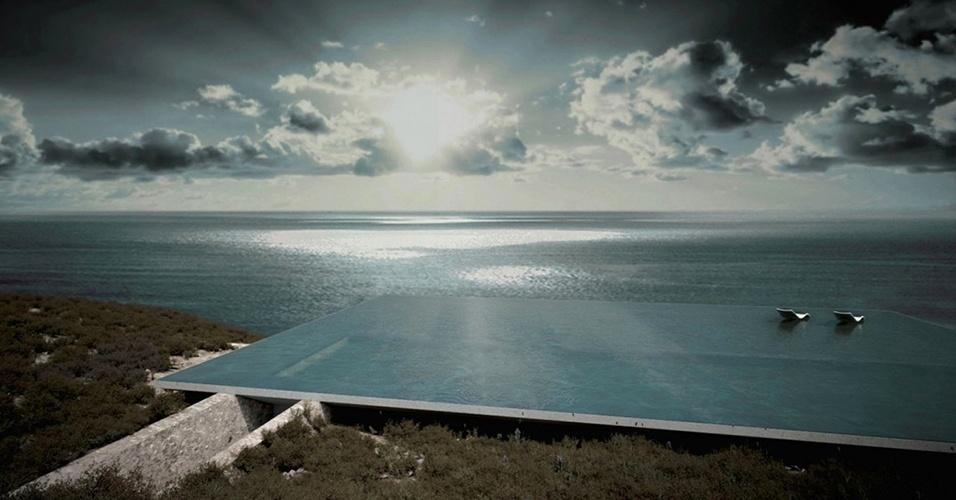 No topo de uma casa, esta piscina com borda infinita se integra às águas do Mar Egeu. A morada com 198 m² fica em em um terreno rochoso da ilha grega de Tinos e tem projeto assinado pelo escritório Kois Associated Architects