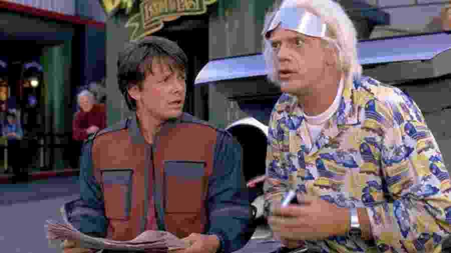 """Michael J. Fox e Christopher Lloyd em cena da franquia """"De Volta para o Futuro"""" - Divulgação"""