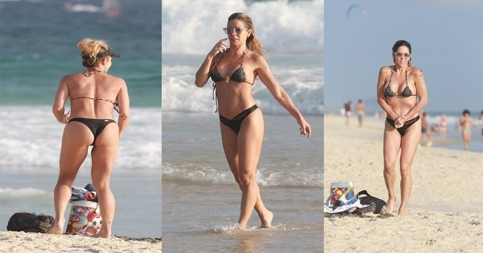 Danielle Winits mostrou que continua em ótima forma. Na tarde desta segunda-feira, a atriz foi fotografada na Barra da Tijuca, na zona oeste do Rio de Janeiro, curtindo um dia de praia com os filhos