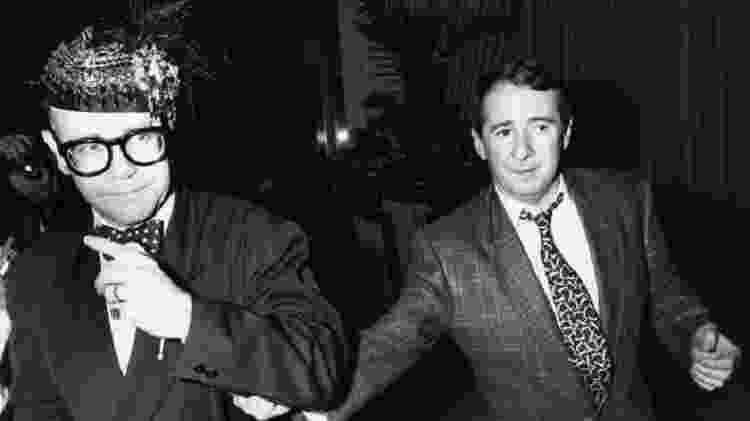 Elton John e John Reid em 1988 - Getty Images