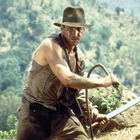 """Harrison Ford em cena de """"Indiana Jones e o Templo da Perdição"""" (1984); nova aventura vai demorar a chegar - Divulgação"""