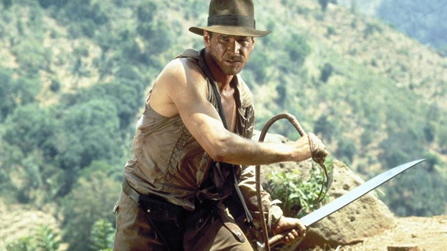 """Harrison Ford em cena de """"Indiana Jones e o Templo da Perdição"""" (1984) - Divulgação"""