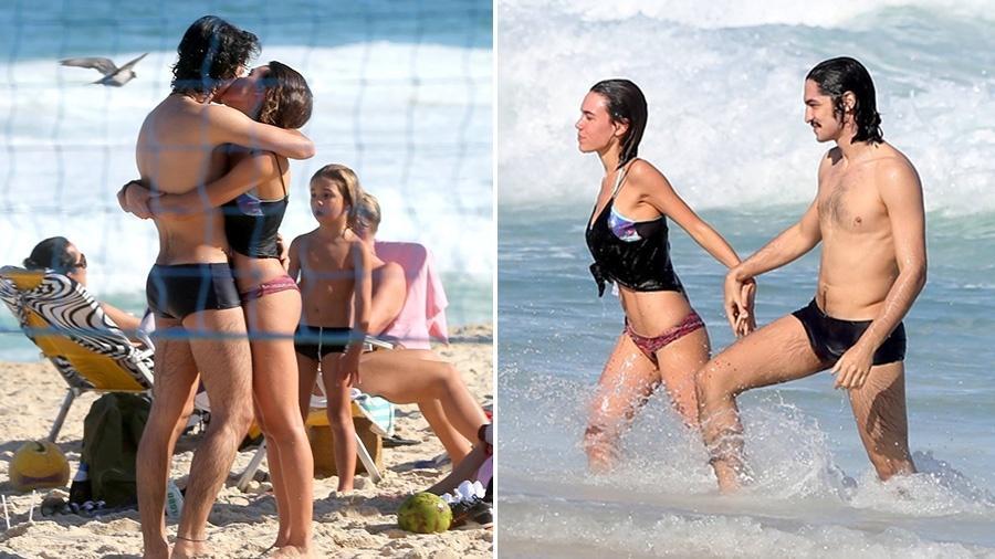 Gabriel Leone e Carla Salle trocam carinhos em praia - AgNews