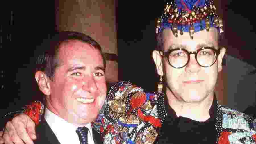 John Reid e Elton John em 1990; empresário foi determinante na construção da persona artística do cantor - Richard Young/Rex/Shutterstock