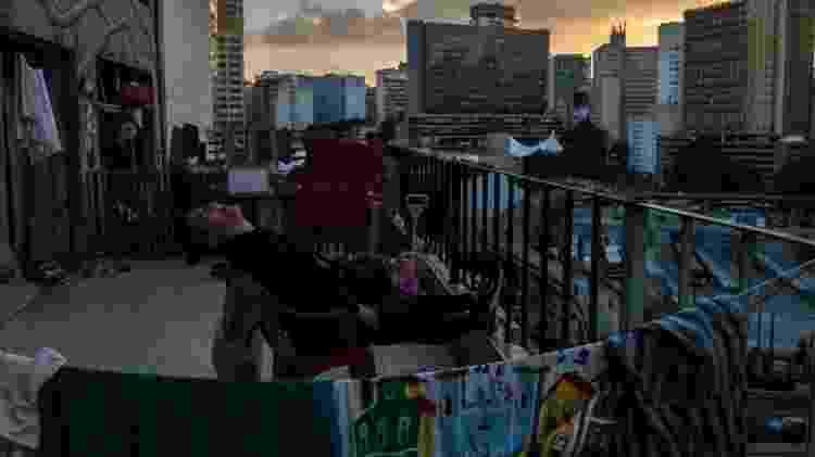 Moradora de prédio ocupado em São Paulo -  NELSON ALMEIDA/AFP -  NELSON ALMEIDA/AFP