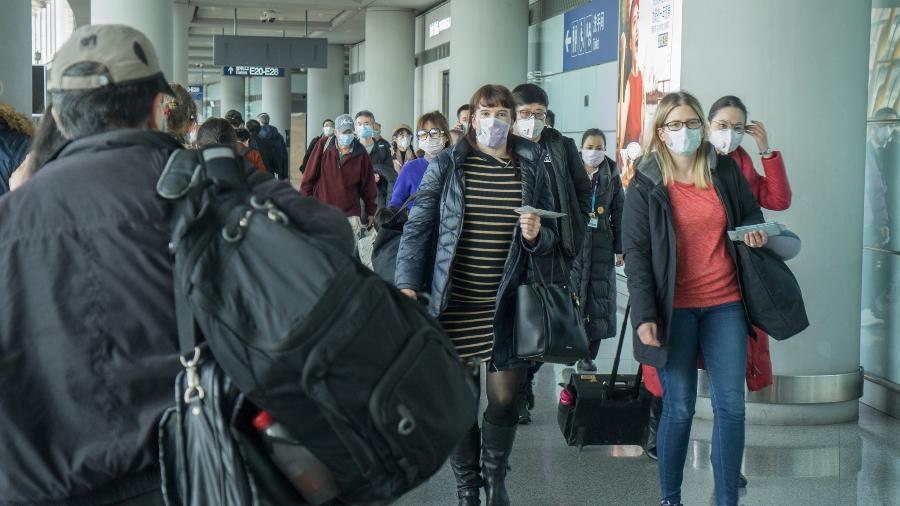 A pandemia do coronavírus deixa o mundo em alerta e congestiona aeroportos  - Getty Images
