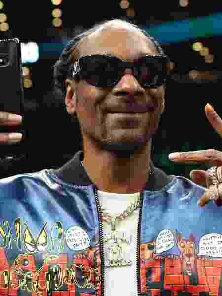 Um dos produtores do festival, Snoop Dogg lida com as polêmicas do evento.  - Maddie Meyer/Getty Images/AFP