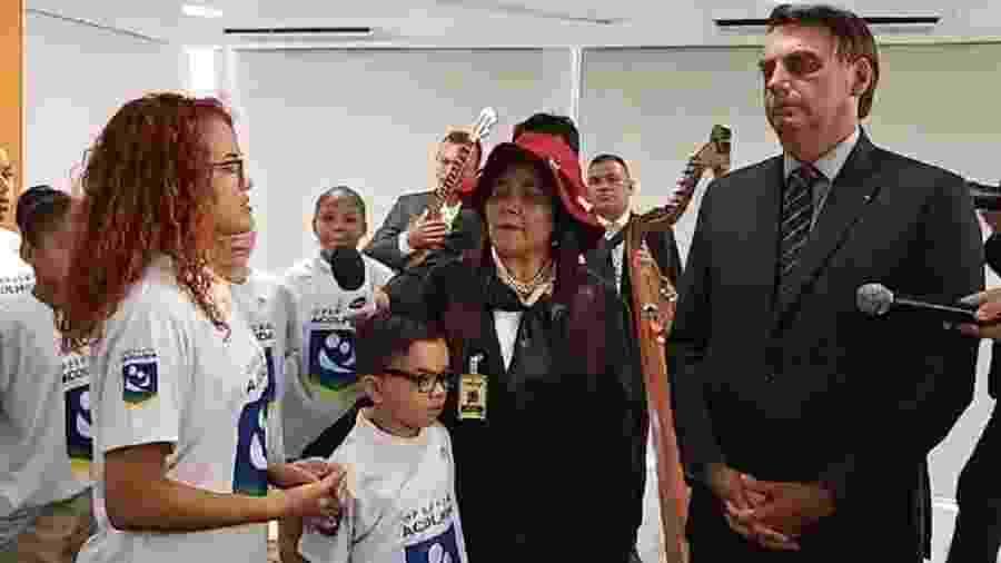 O presidente com jovens venezuelanos que visitaram nesta tarde o Palácio do Planalto e fizeram uma apresentação musical - Reprodução/Youtube