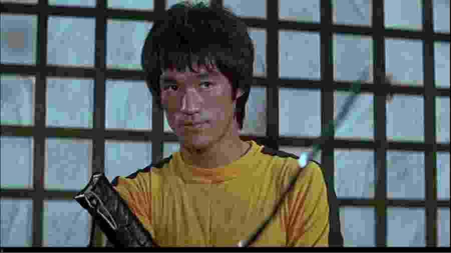 """Mestre das artes marciais, Bruce Lee em cena do último filme da carreira, """"O Jogo da Morte"""" - Divulgação"""