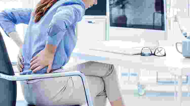 Dor nas costas_trabalho - iStock - iStock