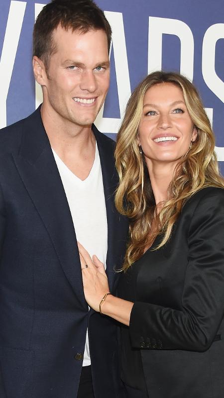Tom Brady e Gisele Bündchen durante um evento - Michael Loccisano/Getty Images