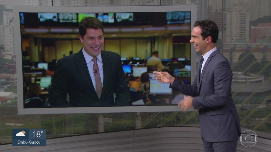 """Evaristo Costa brinca com Cesar Tralli no """"SP1"""" - Reprodução/TV Globo"""