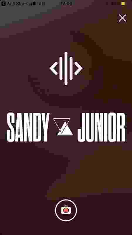 Reprodução da tela do app da dupla Sandy & Junior - Reprodução