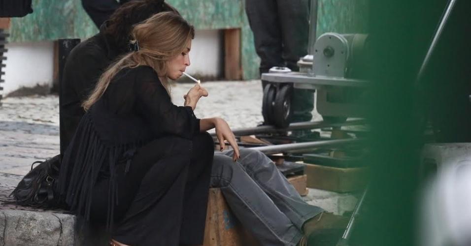 """22.jul.2015 - Na tarde desta quarta-feira, Grazi foi fotografada gravando cenas de """"Verdades Secretas"""" na Barra da Tijuca, na zona oeste do Rio de Janeiro. Na trama, a atriz intepreta Larissa, uma modelo viciada em drogas"""