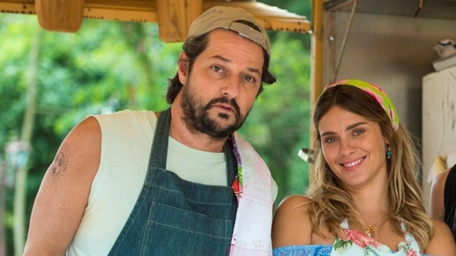 Assumidamente machista, Nicolau (Marcelo Serrado) tem um desejo incontrolável e quem sofre é Afrodite (Carolina Dieckmann).  - Divulgação/TV Globo