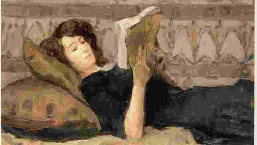 Garota lendo no sofá - Isaac Israels