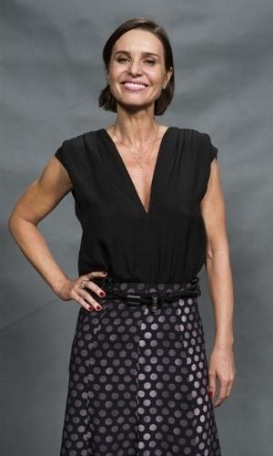Sueli (Paula Burlamaqui) - Dona da pensão onde Atena (Giovanna Antonelli) se abriga quando não está aplicando golpes