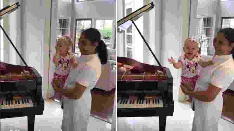Manuela, filha da apresentadora Eliana, no colo na babá - Reprodução/Instagram
