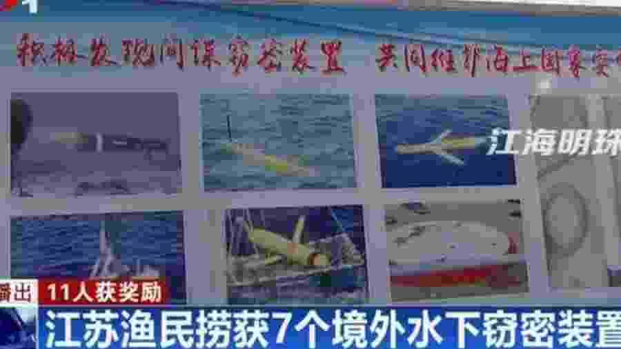Tela de televisão mostra reportagem sobre drones encontrados pelo mar na China - BBC