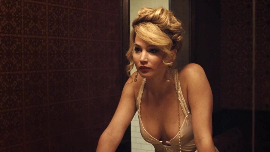 """Jennifer Lawrence em cena de """"Trapaça"""" (2013) - Divulgação"""