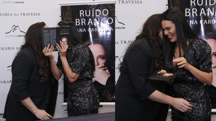 """Leticia Lima dá selinho em Ana Carolina no lançamento do primeiro livro da cantora, """"Ruído Branco"""", em um shopping do Leblon - Ag.News"""