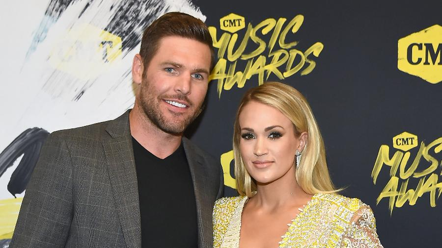 Carrie Underwood e o marido, Mike Fisher - Getty Images