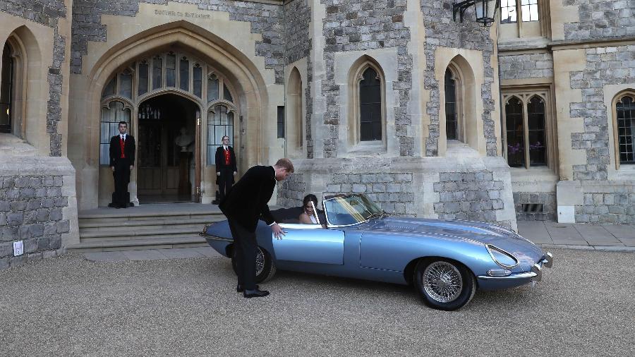 Príncipe Harry e a duquesa de Sussex deixam o castelo de Windsor em um Jaguar elétrico - Steve Parsons/AFP