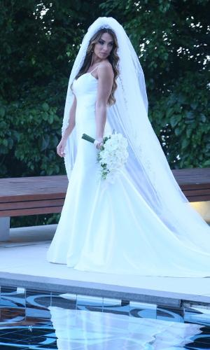 Nicole faz fotos para seu álbum de casamento