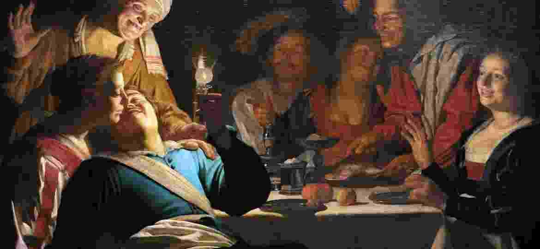 Obra de Gerard van Honthorst (1592-1656) retrata um grupo de amigos bebendo vinho - Universal Images Group via Getty