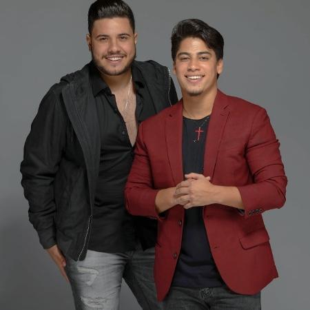 O cantor Henrique (à direita) faz dupla com Netto - Reprodução/Facebook/nettoehenrique
