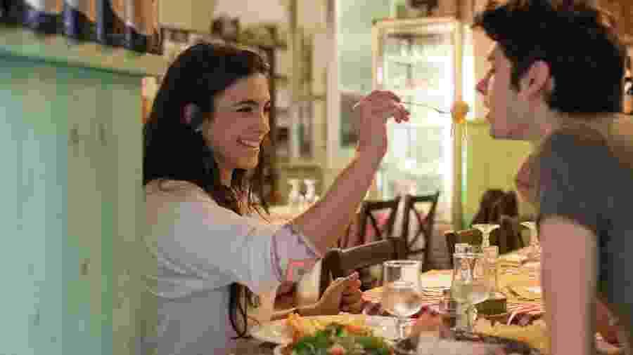 Casal em restaurante na Itália - Getty Images