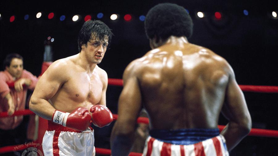 """Sylvester Stallone em cena de """"Rocky, um Lutador"""" (1976) - Reprodução"""