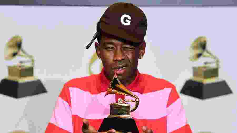 Tyler, the Creator posa com o troféu do Grammy em 2020 - Frederic J. Brown / AFP
