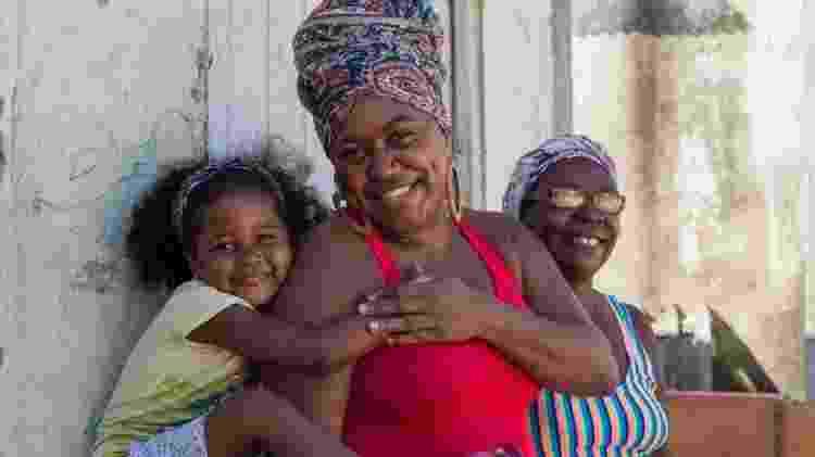 Rejane, com a filha e a mãe, luta pela demarcação das terras do quilombo - Milena Abreu de Oliveira - Milena Abreu de Oliveira