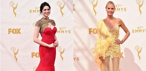 Laura Prepon (à esq.) entrou nos assuntos mais comentados do Twitter por seu look no Emmy, enquanto o vestido Versace de Heidi Klum não agradou - Getty Images