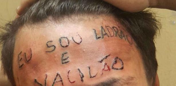 Jovem com a testa tatuada após ser acusado de roubo em São Bernardo (SP)