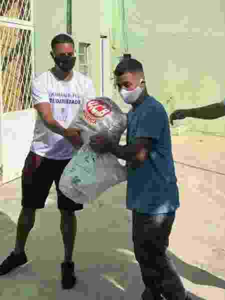 Ação do NÓIZ, grupo que atua na região do Brejo, Cidade de Deus, no Rio - Divulgação - Divulgação